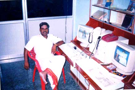 Sre Bhaaskharamaharishi in front of Computer